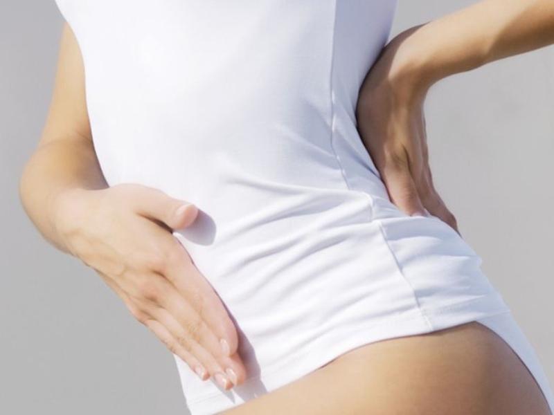 Почему при месячных болит поясница, причины и лечение